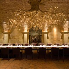 Wine Wednesday: The subterranean tasting room at HALL Rutherford, built with limestone and reclaimed 19th century Austrian bricks, is situated directly below its Sacrashe Vineyard. More than 35 pieces of contemporary art are on display here, but the focal point is the eye-catching chandelier, representing a grapevine root system and accented with 1,500 Swarovski crystals.