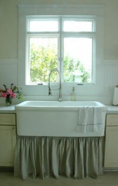 Rie, the blogger behind Home and Harmony, and her husband have become pros at using salvaged sinks. For their kitchen they found a 4-foot-long old surgeon's sink on Craigslist for $100, then spent $300 having it professionally reglazed. It's an incredibly practical farmhouse-style sink that cost much less than newer versions.