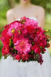 hot pink bridal bouquet this bright pink bridal bouquet has blooms like rinnuculus, dahlias, roses, wax flower and stock. Emphasize the Adorable by Enchanted Florist in Taos, New Mexico. http://www.taosflorist.com/weddings/taos-wedding-flowers/