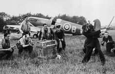 Supermarine Spitfire, with pilots waiting.