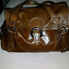 Francesco Biasia Handbag Italian leather with suede interior, zipper pocket in interior. Back pocket and 2 side pockets. Was never used. Francesco Biasia Bags