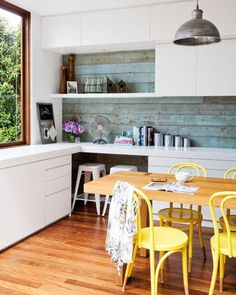 love the rustic weatherboards used as splashbacks and the lights and E likes the chairs!!