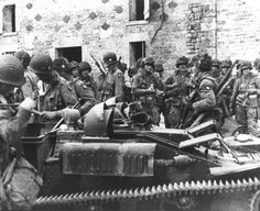 Members of the 101st Airborne Division in the village of St. Marcouf, June 8, 1944