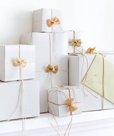 Tie up wrapped gift boxes with cooking twine and farfalle pasta.