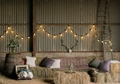 Rustic Hay Bale Seating area & Festoon Lights | Autumn Wedding Styling Inspiration | Styling By Blue Wren Events | Images From John Barwood Photography | http://www.rockmywedding.co.uk/outdoor-autumnal-romance/