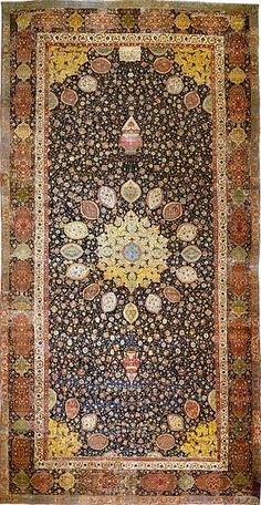 """The Ardabil Carpet is a Persian carpet completed during the reign of Tahmasp I (mid 16th-century). The carpet, which has 26 million knots, was """"in tatters"""" and was restored by sacrificing a similar rug. (Victoria and Albert Museum, London)"""