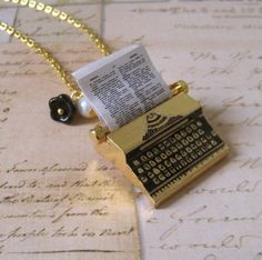 Typewriter Necklace. miniature brass typewriter pendant, glass flower, and pearl  in gold plated chain