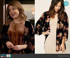 Haley's velvet top and floral kimono jacket on Modern Family. Outfit Details: https://wornontv.net/68403/ #ModernFamily