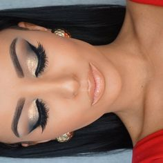 Gorgeous makeup - sharp brows, cat eyeliner, sparkling chrome, grey and gold on the lids and nude peach on the lips