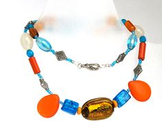 Chunky necklace. Bright colored single strand. Tangerine 0range and blue. Modern jewelry. $26.00, via Etsy.