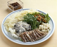 BOSSAM, napa wraps with pork: Bossam is thin slices of boiled pork, served (wrapped) with leaf vegetable such as kimchi, lettuce or sesame leaf. It is often accompanied by a condiment known as ssamjang and usually topped with raw or cooked garlic, onion, pepper, or sometimes raw oyster.