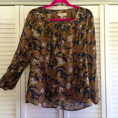 LOFT blouse Beautiful blouse! It's an olive color with blue and lilac colored leaves and white flowers. Very light and flowy. Ties at the neckline. 100% polyester. Marked as petites but I think it could work for standard as well. New with tags. LOFT Tops Blouses