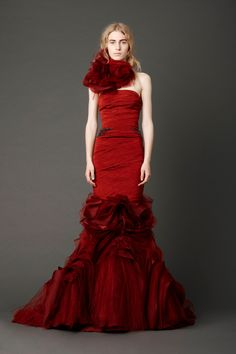 Crimson strapless mermaid gown with hand-draped bodice and inverted flange skirt with embroidered crystal wheat detail