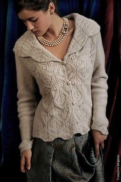 """Kelmscott  Finished measurements: Chest sizes 33 (37,41, 45, 49, 53).  Intended to be worn with 1-2"""" of ease.  Shown in size 36""""  Yarn: Sunday Knits 5-ply yarn: 8 (9, 10, 10, 11, 12) 50-gm skeins.  Shown in Angelic (75% merino, 25% angora) in Bone.  Needle: Size 7 US. Gauge: 20 sts and 27 rows - 4"""" in St st.  Skills used: lace knitting, chart reading, short rows (instructions included)    Kelmscott is available as a pdf download for $7, or as a kit."""