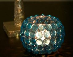 DIY glass bead candle holder is simple, easy and an inexpensive craft. DIY glass bead candle holder is simple, easy and an inexpensive craft. Dollar Store Crafts -Make Your Own Candle Holder I have a bit of an obsession. Diy Candle Holders, Diy Candles, Dollar Store Crafts, Dollar Stores, Glass Bead Crafts, Glass Beads, Centerpiece Decorations, Wedding Centerpieces, Centerpiece Flowers