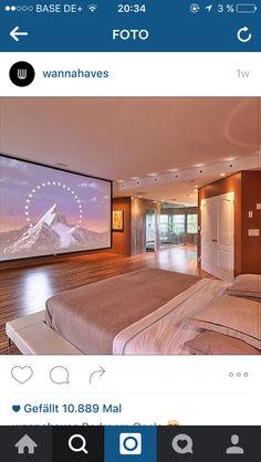 Kinoraum mit steinwand versteckter beamer living - Leinwand schlafzimmer ...
