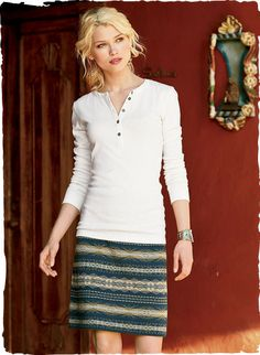 The short, jacquard knit skirt is banded in Andean manta stripes of indigo, stone, sand and teal pima.