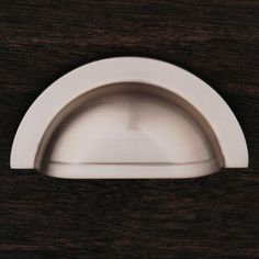 This satin nickel finish cabinet/drawer cup pull with smooth half circle design from RK International is perfect for use on cabinet doors and drawers capable of accepting a mounted pull.