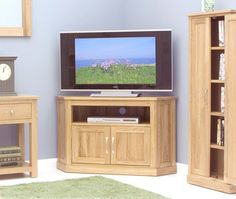 brand new contemporary oak corner tv cabinet the overall dimensions of the corner tv unit are x x cm designed to hold a large up to 50 lcd plasma or led