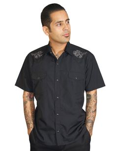 Day of the Dead inspired western shirt, with guitars!   Black snap button shirt with white embroidered Mexican Sugar Skulls and hollow bodied guitar on each side..