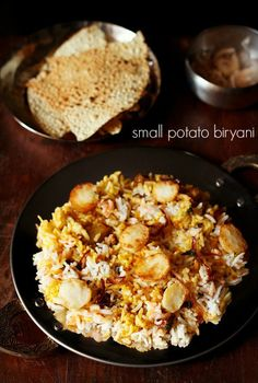 baby potato biryani recipe - dum biryani made with small potatoes.