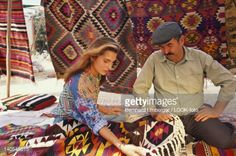 Stock Photo : Tourist and salesman at a market stand with carpets, Bodrum, Turkey, Europe