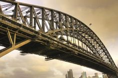 The Sydney Harbour Bridge: Our writer's about to climb it.  If you were to go to the top of a tall building right now, I'd be the girl in the middle of the floor not even daring to look out the window for fear that doing so would throw off the balance of the entire structure and we'd all topple over and plummet to our demise. Which is why it makes perfect sense that on a recent trip to Australia, I signed up to do the Sydney Bridge Climb, a popular sightseeing activity in which you scale…