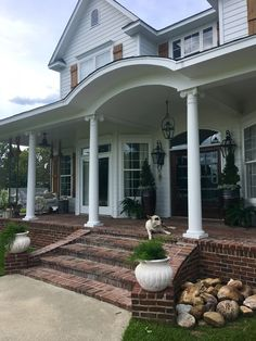 Traditional Farmhouse with Brick Porch. Traditional Farmhouse with Brick Porch. Our house is truly a Southern farm house. White Hardie Board siding, with hand made cypress shutters. The brick is solid and is made in molds by hand to look like old brick the name is Orleans. Traditional Farmhouse with Brick Porch #TraditionalFarmhouse #Brick #Porch Beautiful Homes of Instagram @cindimc.ivoryhome
