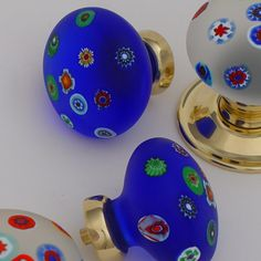 Millefiori glass knobs available from Priors in all sorts of colours. http://www.priorsrec.co.uk/bespoke-glass-door-knobs/p-3-22-47-513