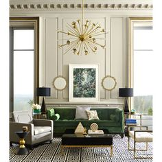 This living room uses brass to accent bold furniture, such as the green sofa and geometric side tables. The crown jewel of this interior is the   brass sputnik chandelier.
