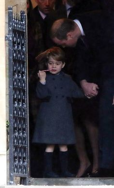 Three-year-old Prince George was given a candy cane as his father thanked the Reverend - b...