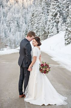 A stunning winter wedding photo. Love the pose and the background just makes it perfect.  | Photography by http://brookebakken.com