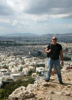 Dr. Ski loves to travel the world. This is him in Athens, Greece looking out at the landscape from the Acropolis right in front of the Parthenon.