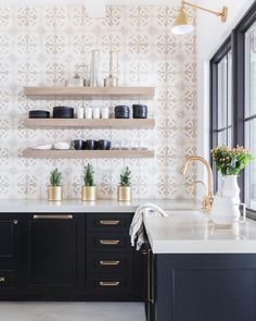 Modern Farmhouse Style Kitchen with black cabinets, modern gold fixtures and pul. Modern Farmhouse Style Kitchen with black cabinets, modern gold fixtures and pulls, decorative tile and rose accents. Farmhouse Style Kitchen, Modern Farmhouse Kitchens, Home Decor Kitchen, Interior Design Kitchen, New Kitchen, Home Kitchens, Kitchen Dining, Kitchen Ideas, Kitchen Inspiration