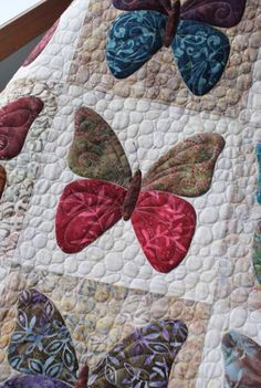 Layer cake butterfly quilt. Pebble quilting makes the butterfly really stand out. I love this pattern