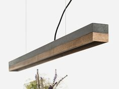 The rectangular pendant lamp is cast from a light grey concrete. It combines modern materials such as copper, brass, oak wood or corten steel with rough concrete into a timeless and elegant designer lamp. The different materials of the lamp Beton Design, Luminaire Design, Lamp Design, Copper Pendant Lights, Pendant Lamp, Pendant Lighting, Turn Up The Lights, Concrete Light, Concrete Wood