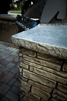 Just in time for those summer BBQ's.  This grill island in Omaha, NE is constructed of lightweight vertically stamped concrete.  This material is extremely versatile in its application.  Installing this material, we can create large stone features without the weight associated with natural stone.