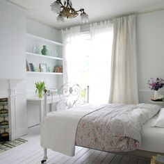 Prevent your white room from feeling bare by adding soft touches of pink and bringing plants and flowers into your room.