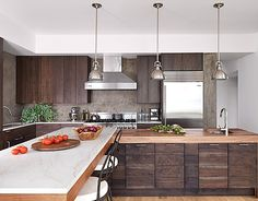Rich walnut cabinets by Robert Bakes and a 16 island that seats eight lend a warm, inviting atmosphere for gatherings in the kitchen of a modern Sag Harbor house by designer Alexandra Fazio of Cecil Baker Walnut Kitchen Cabinets, Wood Cabinets, Timber Kitchen, Concrete Kitchen, Dark Cabinets, Kitchen Interior, New Kitchen, Kitchen Design, Earthy Kitchen