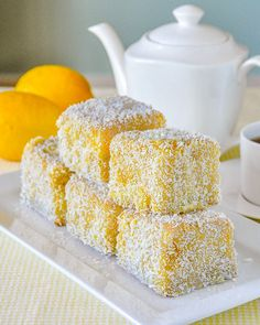 Moist vanilla cake cubes dipped in lemon and coconut. Enjoy th… Lemon Lamingtons. Moist vanilla cake cubes dipped in lemon and coconut. Just enjoy them or dress them with raspberry compote and vanilla cream. Gourmet Recipes, Baking Recipes, Cake Recipes, Dessert Recipes, Mini Cakes, Cupcake Cakes, Lamingtons Recipe, Lamington Cake Recipe, Moist Vanilla Cake