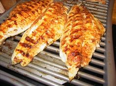 GRILLED CATFISH(From Cook's.com)    Marinade:  1/4 c. lemon juice  2 tbsp. soy sauce  1/4 tsp. each onion and garlic powder  1/4 tsp. pepper  1/4 tsp. paprika (optional)  1/4 tsp. hot sauce  1/4 tsp. olive oil  6 to 8 catfish filets  In a blender, first 5 ingredients for 10 seconds. Gradually add olive oil. Marinate fish for 1 HOUR ONLY in refrigerator.  Grill 1/4 inch to 1/2 inch thick fish 3 to 4 minutes on each side. Skin side cook last.