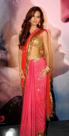 Esha Gupta  in a glamorous sari- Usually wouldn't like glitzy Indian wear but I like it- it's fun, glamourous without being tacky or cheap. I picture a night dancing on a Mehendi/Sangeet!