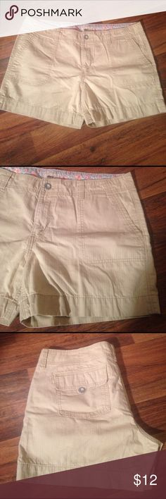 """Levi's size 14 tan shorts Tan colored Levi shorts, size 14. 10 1/2"""" from waist to crotch. 14"""" from waist to bottom hem. Levi's Shorts Jean Shorts"""