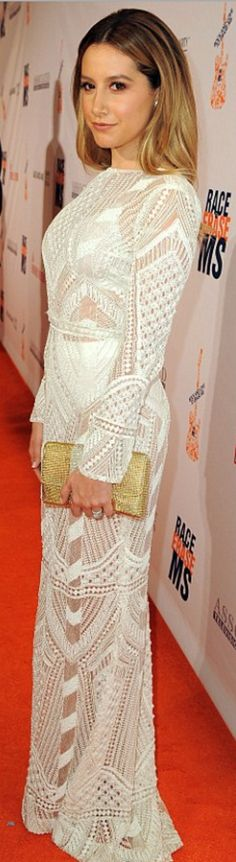 Who made  Ashley Tisdale's white lace long sleeve gown?