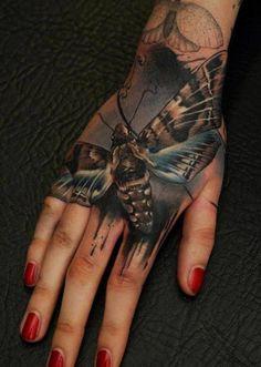 Florian Karg moth butterfly hand tattoo - Best hand tattoos 2013