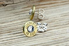 Classy, Dainty Winchester .40 S Brass Bullet Head Stud Earrings with Swarovski Crystals. $24.95, via Etsy.