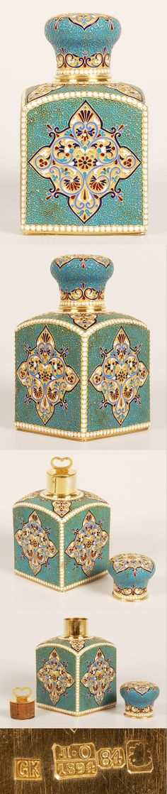 A Russian silver gilt and cloisonne enamel tea caddy by Gustav Klingert, Moscow, circa 1894. Of traditional form with sloping shoulders, the caddy decorated in multi-color diamond shape cartouches against a stippled gilded ground surrounded by filigree and turquoise enamel ground, outlined by rows of white enamel beads, the domed lid similarly decorated. Contains the original gilded silver mounted cork stopper.
