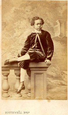 "Portrait of Prince Alamayu, son and heir of Emperor Tewodros II of Ethiopia, wearing western (""American"") clothing and sitting on a balustrade"