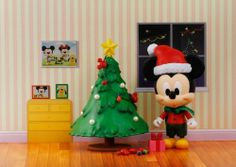"""Disney Play Buddies 3.5"""" Play set - Christmas - Mickey [33149] by Dragon. $29.99. Play Buddies Collection comprises different Disney characters in a setting that brings customers back to their nostalgic childhood.  Christmas...an enjoyable and festive holiday surrounded by loved ones. Now Mickey and Minnie can celebrate with you!  This play set includes Mickey wearing a Santa hat with a Christmas tree filled with decorative lights and presents.  The adorable figure is created by ..."""