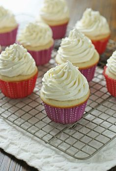 Recipe for double vanilla bean cupcakes. Made with a light and fluffy cupcake base and a vanilla bean swiss meringue buttercream that is silky smooth.